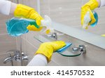 housemaid cleaning a bathroom ... | Shutterstock . vector #414570532