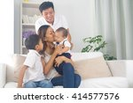 asian family playing with baby   Shutterstock . vector #414577576