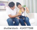 indoor portrait of asian family   Shutterstock . vector #414577588