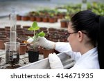 young woman biologist in white... | Shutterstock . vector #414671935