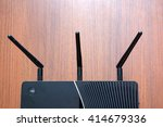 Small photo of antenna Wireless Router wooden background.