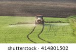 Small photo of Tractor pours fertilizer in agriculture field