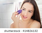 woman applying foundation with... | Shutterstock . vector #414826132