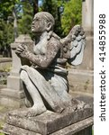 old statue on grave in the... | Shutterstock . vector #414855988