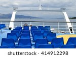 blue chairs on the ferry, empty chairs on one of the greek ferry boats, Empty blue passenger seats on the deck of ferry boat - stock photo