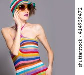 elegant summer woman in stripes ... | Shutterstock . vector #414939472