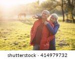happy seniors couple embrace... | Shutterstock . vector #414979732