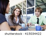 mixed group in business meeting | Shutterstock . vector #415034422