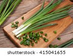 Fresh Green Onions On A Cuttin...