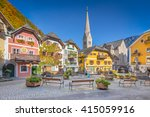 Stock photo scenic picture postcard view of the historic town square of hallstatt with traditional colorful 415059916