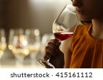 Woman Sniffing Red Wine In A...