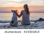 Young Woman With Dog Sitting On ...