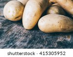 Bunch Of Potatoes On Wooden...