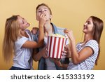 three young people with popcorn | Shutterstock . vector #415333192