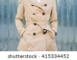 Small photo of Woman in beige coat outdoors closeup