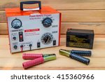 Small photo of Auto Jump starter booster isolated on a wood background