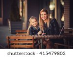 happy family sitting in the... | Shutterstock . vector #415479802