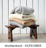 stack of woolen clothes on... | Shutterstock . vector #415515805