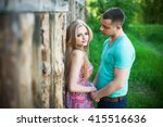 happy couple smiling at the... | Shutterstock . vector #415516636