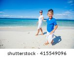 mother with her son walking on... | Shutterstock . vector #415549096