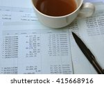 Small photo of Saving account from bank with a cup of coffeeand pen for financial and loan