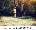 young woman trail runner... | Shutterstock . vector #415725166