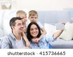 happy family making selfie on... | Shutterstock . vector #415736665
