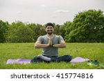 Man Doing Yoga Exercises In Th...