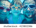Family Having Fun In Swimming...