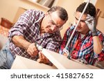 two carpenters working at... | Shutterstock . vector #415827652