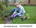 planting flowers in the soil ... | Shutterstock . vector #415942045