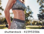 midsection shot of fit woman in ... | Shutterstock . vector #415953586