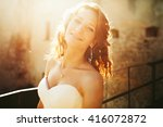 bride smiles and shines in the... | Shutterstock . vector #416072872