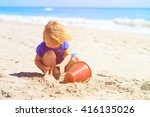 little girl play with sand on... | Shutterstock . vector #416135026