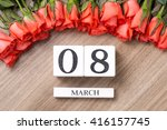 Red Rose On A Wooden Background....