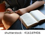 women use phone with open book ... | Shutterstock . vector #416169406
