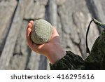 stone in a child's hand | Shutterstock . vector #416295616