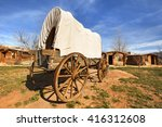 Old Covered Wagon In A Pioneers'...