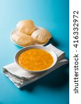 Small photo of Aamras or Aam Ras Puri: Puri which is an indian fried small bread and alphonso mango pulp is a popular lunch especially during Padwa, the Marathi new year, maharashtrian lunch/dinner menu