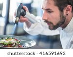 chef flambe goat cheese on... | Shutterstock . vector #416591692