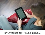 woman reading a digital book at ... | Shutterstock . vector #416618662