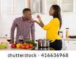 photo of young man testing food ... | Shutterstock . vector #416636968