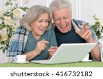 senior couple  with laptop | Shutterstock . vector #416732182