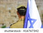 Israeli Soldier With Flag Of...