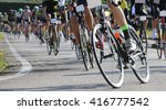 Small photo of race bike and professional cyclists during the cycling race