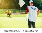 golf   caddy holding flag ... | Shutterstock . vector #416835772