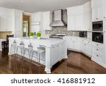 Stock photo kitchen interior with island sink cabinets oven range and hardwood floors in new luxury home 416881912