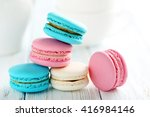 tasty french macarons on a blue ... | Shutterstock . vector #416984146