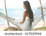 happy girl lying in a hammock... | Shutterstock . vector #417030946