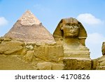 The sphinx with a pyramid in the background - stock photo